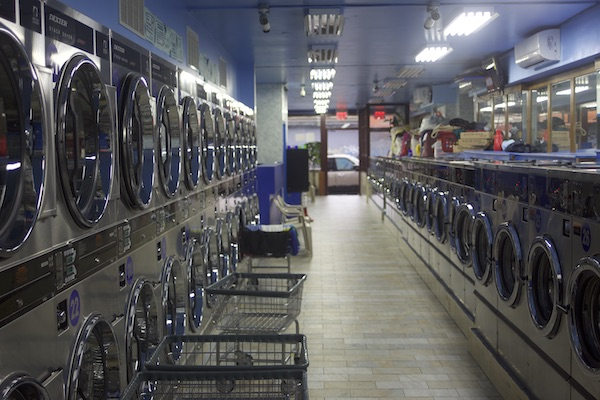 Inside of a laundromat showing washers and dryers