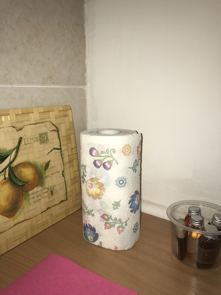 A paper towel roll printed with colourful flowers